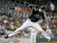 Atlanta Braves' Alex Wood delivers a pitch against the Houston Astros in the first inning of a baseball game, Wednesday, June 25, 2014, in Houston. (AP Photo/Pat Sullivan)