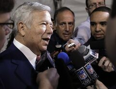 New England Patriots owner Robert Kraft, center, answers questions on Thursday, Feb. 2, 2012, in Indianapolis. The Patriots are scheduled to face the New York Giants in NFL football Super Bowl XLVI on Feb. 5. (AP Photo/Mark Humphrey)