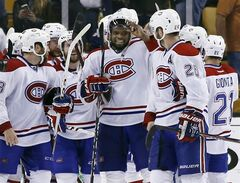 Montreal Canadiens defenseman P.K. Subban, middle, and his teammates celebrate after defeating the Boston Bruins 3-1 in Game 7 of an NHL hockey second-round playoff series in Boston, Wednesday, May 14, 2014. (AP Photo/Elise Amendola)