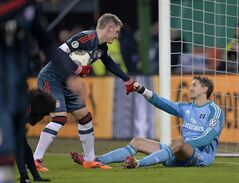 Bayern's Bastian Schweinsteiger, left, helps Hamburg goalkeeper Rene Adler to get up after he received the fifth goal during the quarterfinal match of the German soccer cup between Hamburger SV and Bayern Munich in Hamburg, Germany, Wednesday, Feb. 12, 2014. (AP Photo/Martin Meissner)