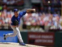 Chicago Cubs starting pitcher Travis Wood throws during the first inning of a baseball game against the St. Louis Cardinals, Sunday, Aug. 31, 2014, in St. Louis. (AP Photo/Jeff Roberson)