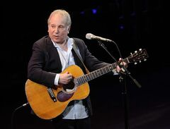 FILE - This April 2, 2012 file photo shows singer Paul Simon performing at