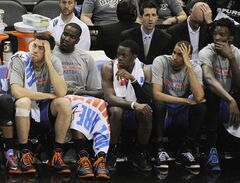 Oklahoma City Thunder players sit on the bench in the closing minutes of Game 2 of a Western Conference finals NBA basketball playoff series against the San Antonio Spurs, Wednesday, May 21, 2014, in San Antonio. San Antonio won 112-77. (AP Photo/Darren Abate)