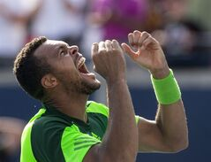 France's Jo-Wilfried Tsonga celebrates after beating Switzerland's Roger Federer 7-5 7-6 to win the Men's Rogers Cup singles final in Toronto on Sunday August 10, 2014. THE CANADIAN PRESS/Chris Young