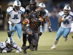 B.C. Lions running back Stefan Logan (10) takes off upfield during first half CFL action against the Toronto Argonauts in Toronto on Sunday August 17, 2014. THE CANADIAN PRESS/Frank Gunn