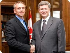 Churchill Conservative candidate Wally Daudrich, seen here in a photo on his website with Prime Minister Stephen Harper.