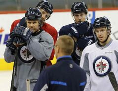Jokinen (left), returned to the ice with his teammates to practice today after winning an Olympic bronze medal with Team Finland.