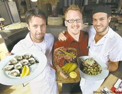 (L-R) Tristan Foucault with the Village Bay oysters; general manager Richard Hanna shows off a charcuterie platter; Chris Gama, chef de cuisine with Half Pints beer braised, Oka stuffed pork chop.