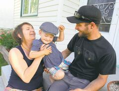 Hands-on parenting: Amy Frank with husband Kenneth and son Sullivan.