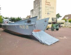 The landing craft used by Tom Hanks in Saving Private Ryan and other military relics sit in the courtyard of a German bunker in the port city of Ouistreham. Credit obrien