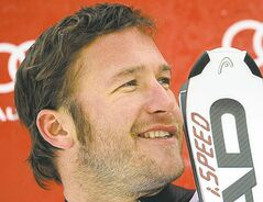 FILE - Bode Miller, of the United States, smiles as he stands on the podium after completing an alpine ski, men's World Cup downhill, in Chamonix, France, in this Friday, Feb. 3, 2012 file photo. Miller's equipment supplier says the skier is skipping the opening race of the World Cup season to rest his surgically repaired left knee. Miller had knee surgery eight months ago. The opening World Cup race is Oct. 28 in Austria. (AP Photo/Shinichiro Tanaka, File)