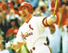 FILE - This is a Sept. 27, 1998 file photo showing St. Louis Cardinals' Mark McGwire watching his record-setting 70th home run of the season against the Montreal Expos, in the seventh innning at Busch Stadium, in St. Louis. McGwire has finally come clean, admitting he used steroids when he broke baseball's home run record in 1998. McGwire said in a statement sent to The Associated Press on Monday, Jan. 11, 2010, that he used steroids on and off for nearly a decade and he was apologizing.  (AP Photo/Ed Reinke, File)