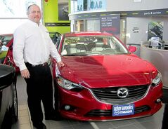 Gerry Gordon Mazda sales rep Dave Hallock with 2014 Mazda 6.