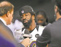 Baltimore Ravens safety Ed Reed is surrounded by inquiring minds Friday in the Superdome.