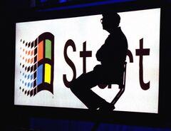 Bill Gates sits on stage at the Windows 95 Launch in Redmond, Wash. THE CANADIAN PRESS/AP, files