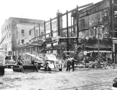 On June 8, 1954, just after 1 a.m., the first call came into the fire department about flames in the Time Building. The blaze began in the false ceiling above the main-floor retail level of the building, making it difficult to get at. Winds of up to 120 hm/h helped fuel the flames and spread embers throughout the building. By 6 a.m., it was a three-alarm fire with 207 firemen and 26 vehicles at the scene.