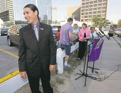 A relaxed Robert-Falcon Ouellette shares a laugh with a reporter before making an announcement Friday morning on surface parking in the downtown.