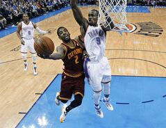 Cleveland Cavaliers guard Kyrie Irving (2) shoots in front of Oklahoma City Thunder forward Serge Ibaka (9) during the fourth quarter of an NBA basketball game in Oklahoma City, Wednesday, Feb. 26, 2014. Cleveland won 114-104. (AP Photo/Sue Ogrocki)