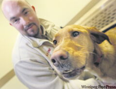 Handler Dave LaBelle with Oscar the dog whose job is to sniff out bedbugs, which are a nuisance to health-care workers.