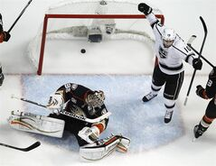 Los Angeles Kings center Mike Richards, right, celebrates his goal past Anaheim Ducks goalie John Gibson during the first period in Game 7 of an NHL hockey second-round Stanley Cup playoff series in Anaheim, Calif., Friday, May 16, 2014. (AP Photo/Chris Carlson)