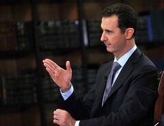 In this photo, which AP obtained from Syrian official news agency SANA, has been authenticated based on its contents and other AP reporting, President Bashar Assad gestures as he speaks during an interview with Italy's RAI News 24 TV, at the presidential palace in Damascus, Syria, Sunday, Sept. 29, 2013. Assad says his government will abide by last week's U.N. resolution calling for the country's chemical weapons program to be dismantled and destroyed. (AP Photo/SANA)