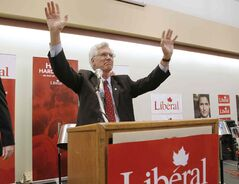 Jim Carr raises his arms in victory after taking the Winnipeg South Centre Liberal party nomination at the Centro Caboto Centre Monday.