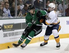Dallas Stars' Alex Chiasson (12) attempts to gain control of the puck behind the visitors net as Nashville Predators' Mattias Ekholm (42) defends in the first period of an NHL hockey game, Friday, March 28, 2014, in Dallas. Chiasson welcomes the expectations with the Ottawa Senators that come after the Jason Spezza trade. THE CANADIAN PRESS/Tony Gutierrez