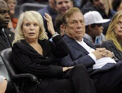 Shelly Sterling sits with her husband, Donald Sterling, right, during a Los Angeles Clippers' NBA basketball game in Los Angeles on Nov. 12, 2010. THE CANADIAN PRESS/AP, Mark J. Terrill