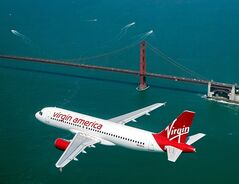 A Virgin America plane is pictured in flight in a handout photo. THE CANADIAN PRESS/ HO, Virgin America