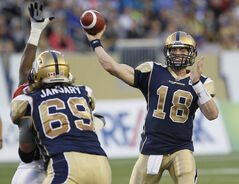 Winnipeg Blue Bombers quarterback Justin Goltz unloads a pass against the Calgary Stampeders during the second half of their game at Investors Group Field Friday.