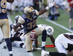 Winnipeg Blue Bombers' Nic Grigsby (32) disputes an out-of-bounds call in the Ottawa Redblacks' end zone during the first half of CFL action in Winnipeg Thursday, July 3.