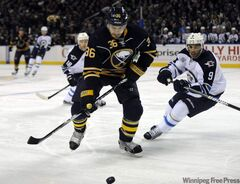 Buffalo Sabres' Patrick Kaleta (36) battles for the puck with Winnipeg Jets' Evander Kane (9) during the first period in Buffalo, N.Y., Saturday.