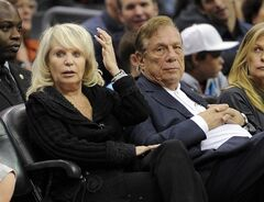 FILE - In this Nov. 12, 2010, file photo, Shelly Sterling sits with her husband, Donald Sterling, right, during the Los Angeles Clippers' NBA basketball game against the Detroit Pistons in Los Angeles. Shelly Sterling's attorneys have asked a court on Thursday June 19, 2014, to hold a hearing on allegations that Donald Sterling and his attorneys have threatened her legal team and the doctors who assert that the Los Angeles Clippers co-owner is mentally incapacitated.(AP Photo/Mark J. Terrill, File)