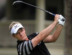 Englishman Luke Donald scorches a drive off the eighth tee during the third round of the RBC Heritage in Hilton Head Island, S.C., Saturday. Donald shot 66 for an one-shot lead.