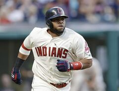 Cleveland Indians' Carlos Santana watches his solo home run off Detroit Tigers starting pitcher Justin Verlander in the fourth inning of a baseball game, Saturday, June 21, 2014, in Cleveland. (AP Photo/Tony Dejak)
