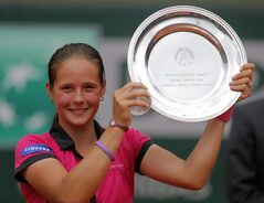 Russia's Darya Kasatkina holds her trophy after winning the junior girls' final match against Serbia's Ivana Jorovic of the French Open tennis tournament at the Roland Garros stadium, in Paris, France, Saturday, June 7, 2014. Kasatkina won 6-7, 6-2, 6-3. (AP Photo/Michel Spingler)
