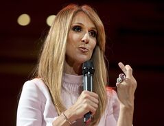 Celine Dion crosses her fingers as she speaks about her husband and manager, Rene Angelil, second bout with cancer after a charity event Wednesday, July 16, 2014 in Montreal.THE CANADIAN PRESS/Ryan Remiorz