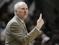 San Antonio Spurs hcoach Gregg Popovich yells to his players during the second half of an NBA basketball game against the Sacramento Kings on Saturday, Feb. 1, 2014, in San Antonio. San Antonio won 95-93. (AP Photo/Darren Abate)