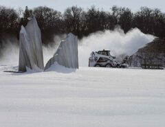 The area around Gordon Reeves' stainless steel sculpture, Agassiz Ice, at Assiniboine Park is cleared for visitors Monday by a giant snowblower. The art piece was designed as a remembrance of prehistoric Lake Agassiz ice, but with these cold January temperatures, no reminder was needed today.