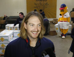 Pitcher Brendan Lafferty volunteered with other Goldeyes staff at Winnipeg Harvest this morning.