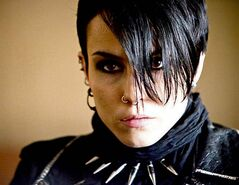 Noomi Rapace as Lisbeth Salander (above, below)