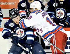 Tobias Enstrom (left) is one of four Winnipeg defencemen currently out of the lineup due to injury.
