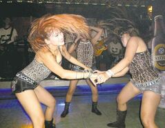 Singers perform during a dangdut show at a pub in Jakarta, Indonesia, last month.
