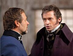 Russell Crowe and Hugh Jackman face off in Les Mis��rables.