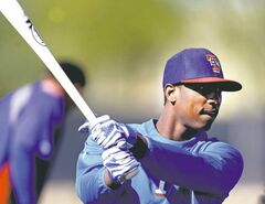 Texas Rangers shortstop Jurickson Profar swings a bat during spring training in Surprise, Arizona, Saturday February 16, 2013.