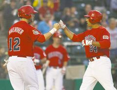 Winnipeg's Casey Haerther (left) congratulates teammate Fehlandt Lentini on his two-run home run Friday night.