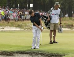Amateur, Matthew Fitzpatrick, England, hits a chip on the 11th hole during the first round of the U.S. Open golf tournament in Pinehurst, N.C., Thursday, June 12, 2014. (AP Photo/Charles Riedel)