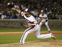 Chicago White Sox relief pitcher Zach Putnam delivers during the ninth inning of a baseball game against the Houston Astros Friday, July 18, 2014, in Chicago. The White Sox won 3-2. (AP Photo/Charles Rex Arbogast)