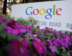 FILE - In this Oct. 8, 2010 file photo, the Google logo is displayed outside Google headquarters in Mountain View, Calif. Google executives and Texas Gov. Rick Perry are expected Tuesday, April 9, 2013 to name tech-savvy Austin as the second city where the search giant will offer its ultra-fast home Internet service. Last summer, Kansas City became the first metro area in the U.S. to receive Google Fiber. (AP Photo/Paul Sakuma, File)
