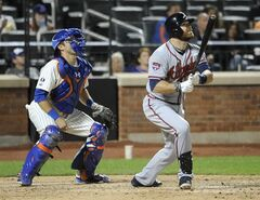 New York Mets catcher Travis d'Arnaud and Atlanta Braves' Ryan Doumit watch Doumit's two-run home run off New York Mets relief pitcher Daisuke Matsuzaka in the ninth inning of a baseball game at Citi Field on Thursday, Aug. 28, 2014, in New York. (AP Photo/Kathy Kmonicek)